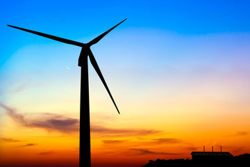 silhouette wind turbine generator with factory emissions of carb