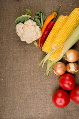 vegetables: onions, peppers, cabbage, tomatoes, corn