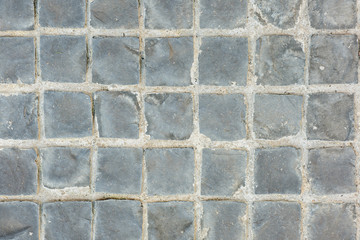 Texture of exposed cement floor tiled.