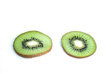 Whole kiwi fruit and his sliced segments isolated