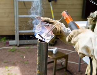Welder, repairing the gardening equipment