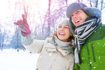 Winter Vacation. Happy Couple Having Fun Outdoors