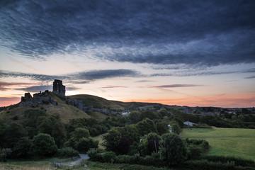Beautiful Summer sunrise over landscape of medieval castle ruins