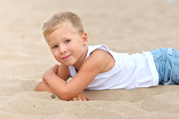 Portrait of boy on the beach in summer