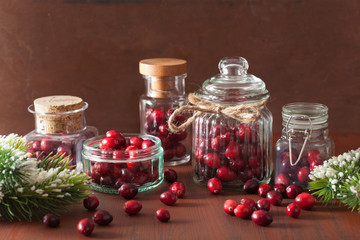fresh cranberry in glass jars, winter decoration