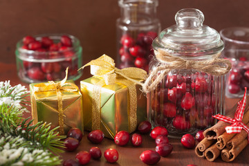 fresh cranberry in glass jars, winter decoration and gifts