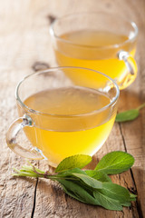 herbal sage tea with green leaf in glass cups