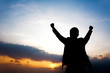 Silhouette of man raising his arms - success & winning concept