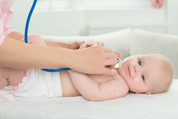 pediatrician inspection of little baby