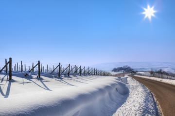 Road through snowy hills.