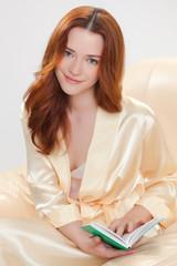 beautiful girl in a beige smock
