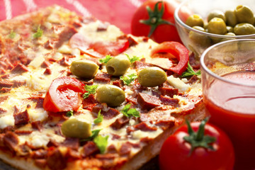 Home made pizza with olives and tomatoes