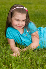 Smiling little girl on the grass