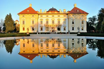 Slavkov castle reflected in water