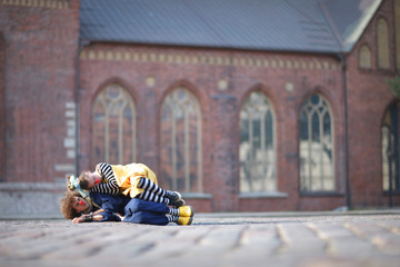 Clown couple at the town square, love and care concept