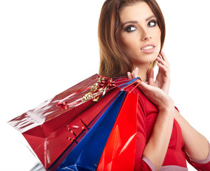 Young woman with shopping bags over white background