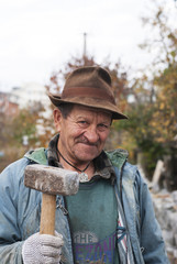 old man with a hammer