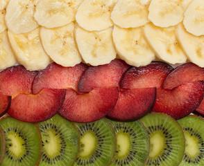 background with kiwi, plum and banana
