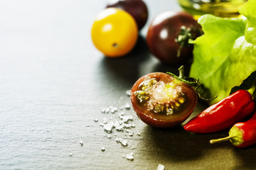 Fresh grape tomatoes with salade leaves and salt