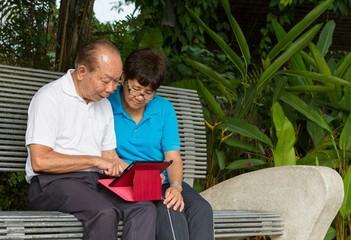 Senior couple on computer tablet