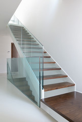 wooden stairs with glass balustrade