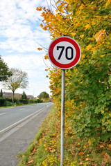 Speed limit road sign of 70 kilometres per hour