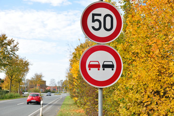 Speed limit road sign of 50 kilometres per hour no overtaking