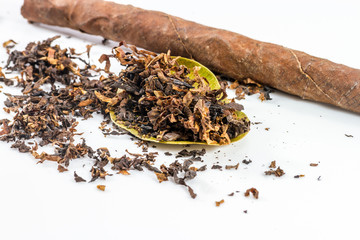 close-up of pile of tobacco on white background.