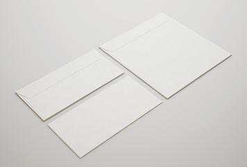 White envelopes on light background