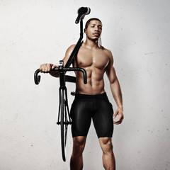 Portrait of an athlete with bicycle