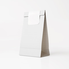 White paper bag with white sticker on light background