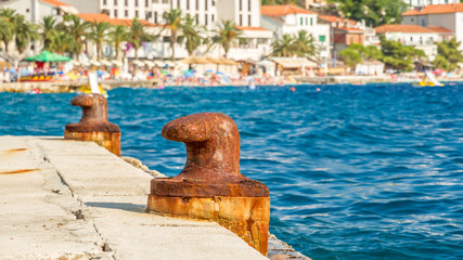 two abandoned iron rusty piers in a mediterrean harbor