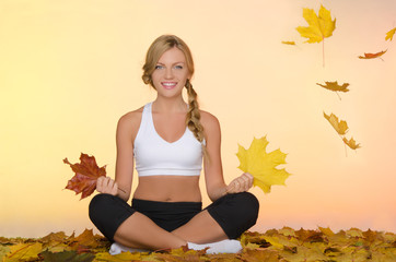 smiling woman sitting practice yoga under leaves