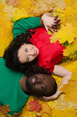 Asian and black on autumn leaves