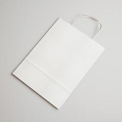 Brown paper bag with handles clear background