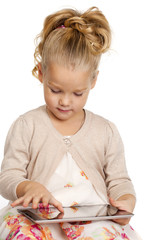 Little girl with tablet gadget isolated white background