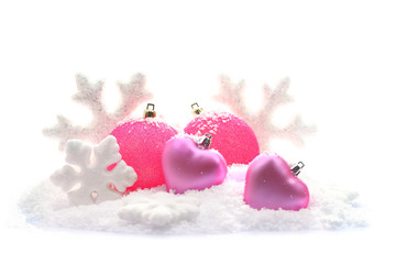 Christmas ornaments on snow isolated on white background