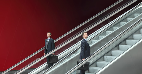 business man going up and down escalators, concept of success
