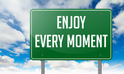 Enjoy Every Moment on Highway Signpost.