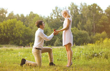 Man giving a ring woman, love, couple, date, wedding - concept