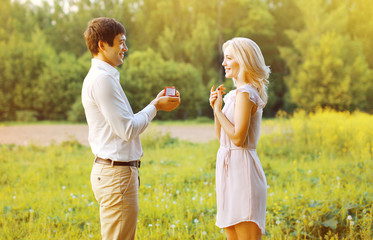 Love, couple, date, wedding concept - Man proposing ring woman