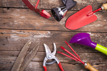 Gardening tools over a wooden background