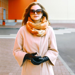 Beautiful woman in coat in the city