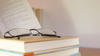 Closeup of open book and eyeglasses. Education concept.