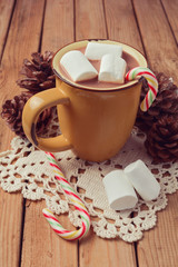 Hot chocolate and marshmallows on wooden table