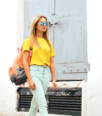Street fashion, stylish hipster girl in sunglasses posing in the