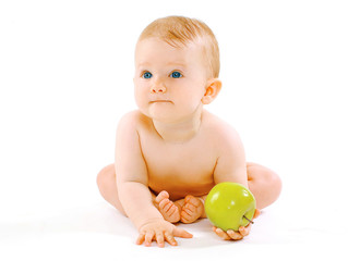 Food, health and child concept. Cute baby with green apple on a