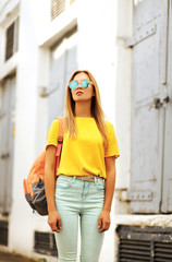 Summer, fashion and people concept - stylish pretty woman in sun