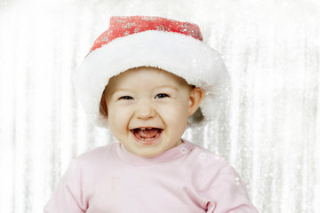 Cute baby girl with Santa hat