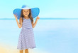 Leinwanddruck Bild - Summer, vacation, travel and people concept - pretty little girl